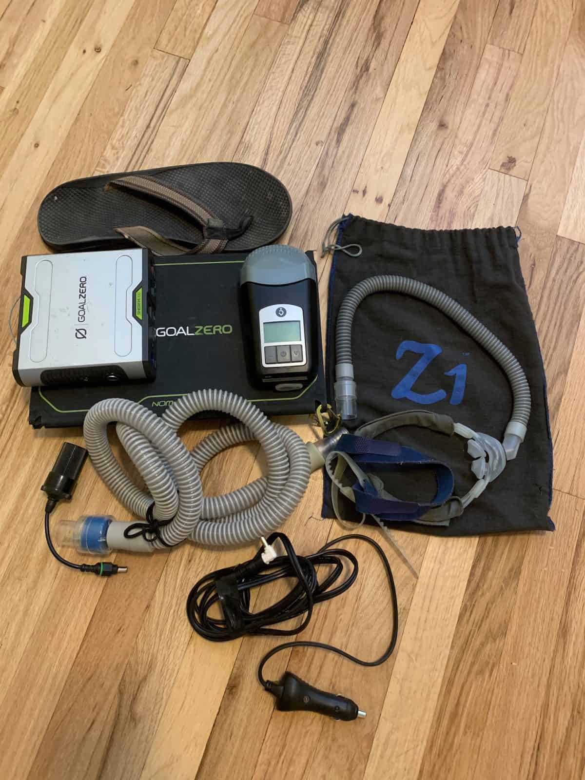 Complete Solar CPAP kit with size 12 Chaco sandal for scale